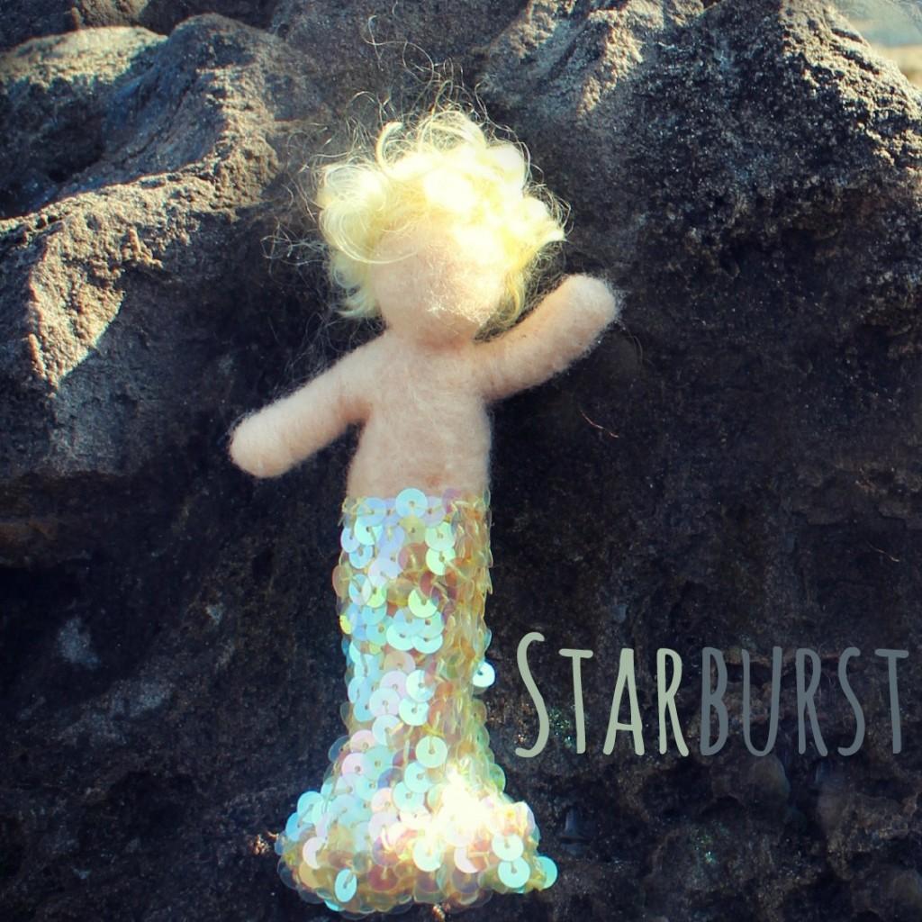1309012 square. blonde merbaby Starburst waving in the sunshine. No logo