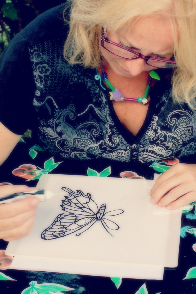 130910 Denise painting a swallowtail butterfly on silk using black Gutta resist