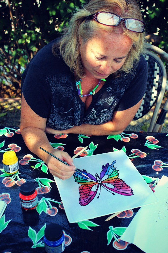 130910 Denise painting her rainbow swallowtail butterfly on silk