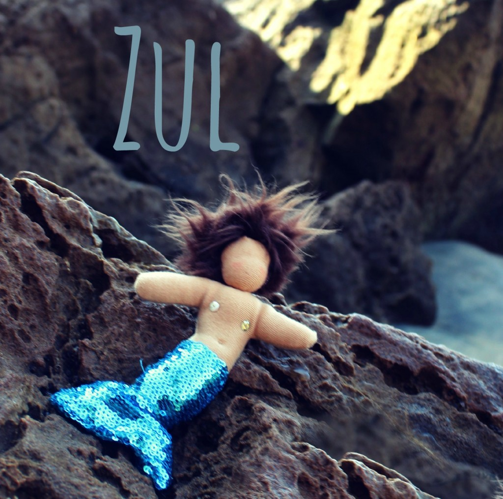 130912 Zul with words. Handstitched merboy Zul on rocks at Lookout Point beach