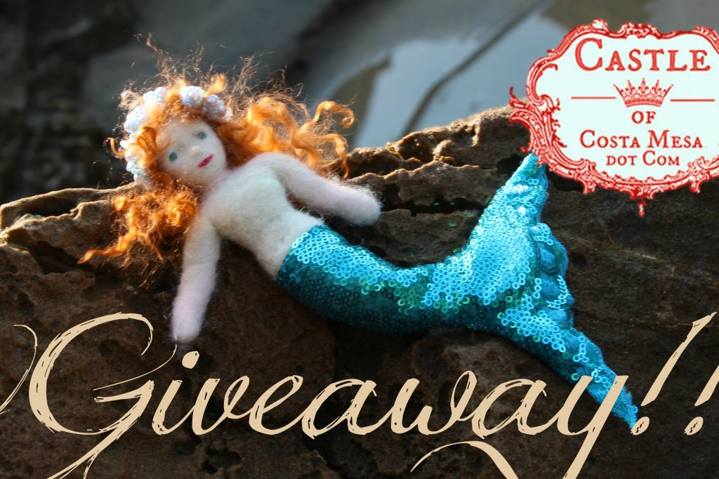 130914 Giveaway. Mermaid Georgina basking on rock