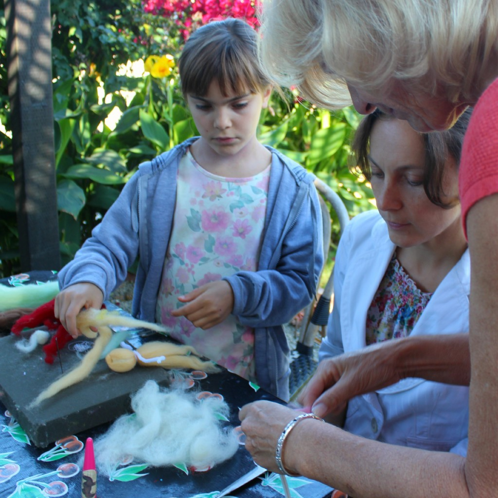 130927 Christine showing Alena and Anicka how to make pulled wool roving angels