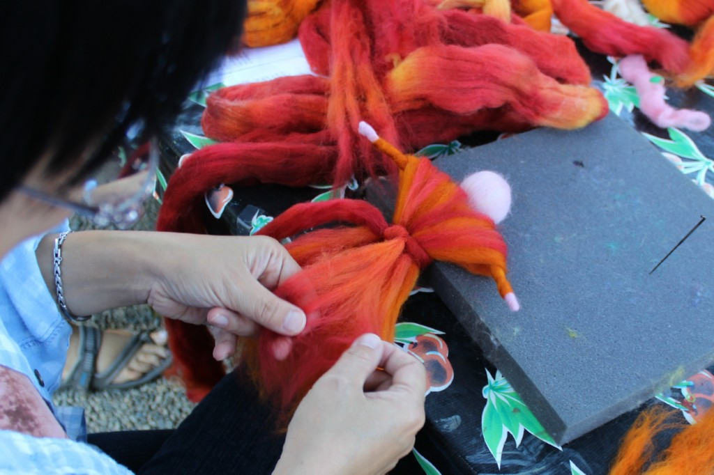 130927 Josephine arranging the fibers on her roving angel's flowing skirt