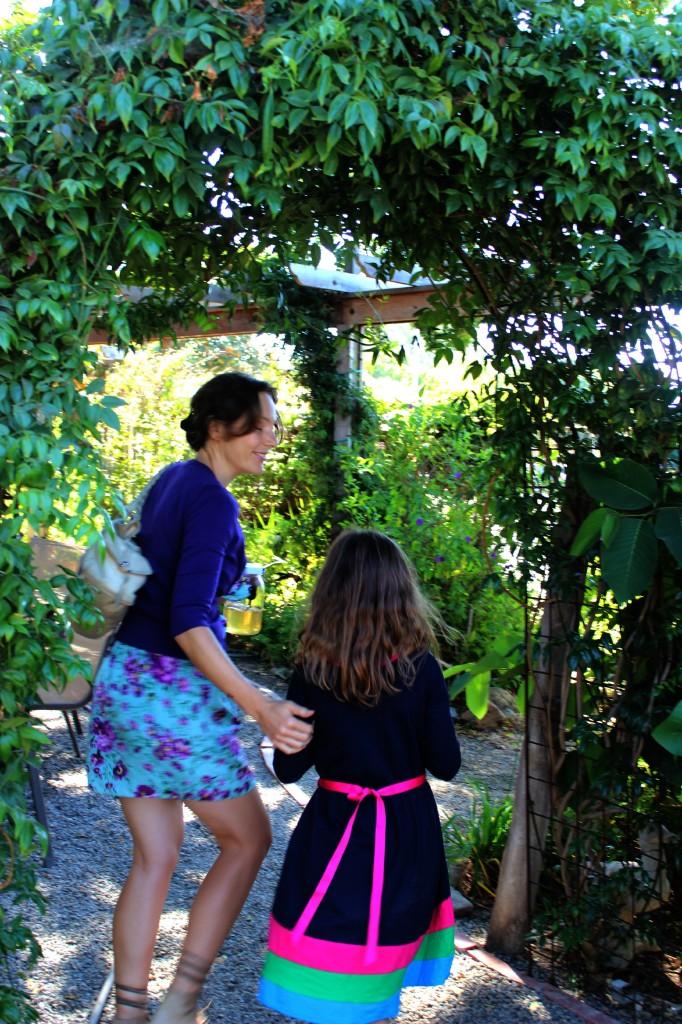 131001 Alena leaving craft group under trellis