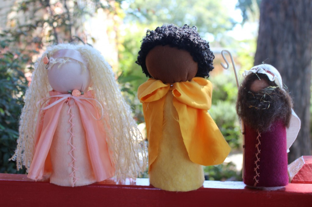 131001 Josephine's blonde princess, Jzin's Nubian prince and Christine's Nativity shepard table top puppet dolls on a red ledge