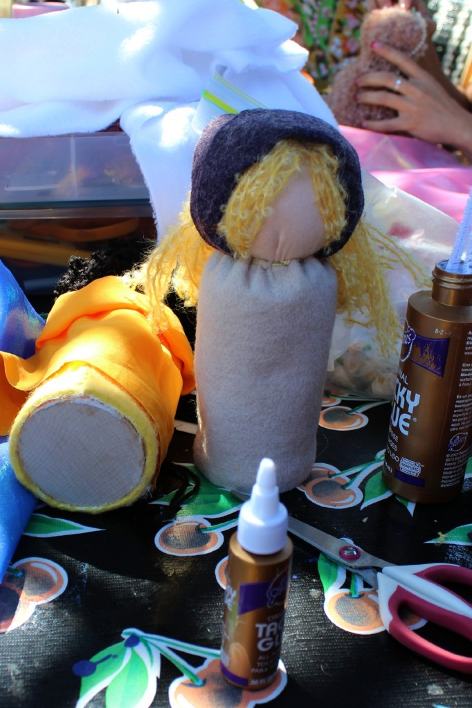 131001 gluing wooden disc to the base of table top puppet doll