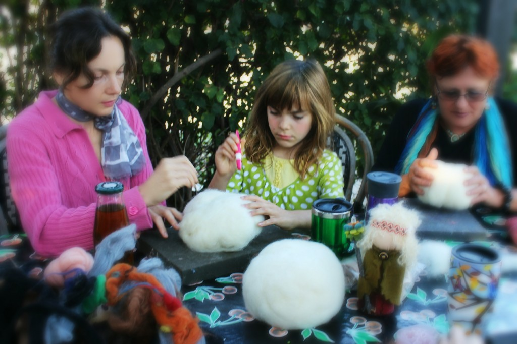 131015 Alena, Anicka, Gisela needle-felting balls of wool batting into pumpkin shapes