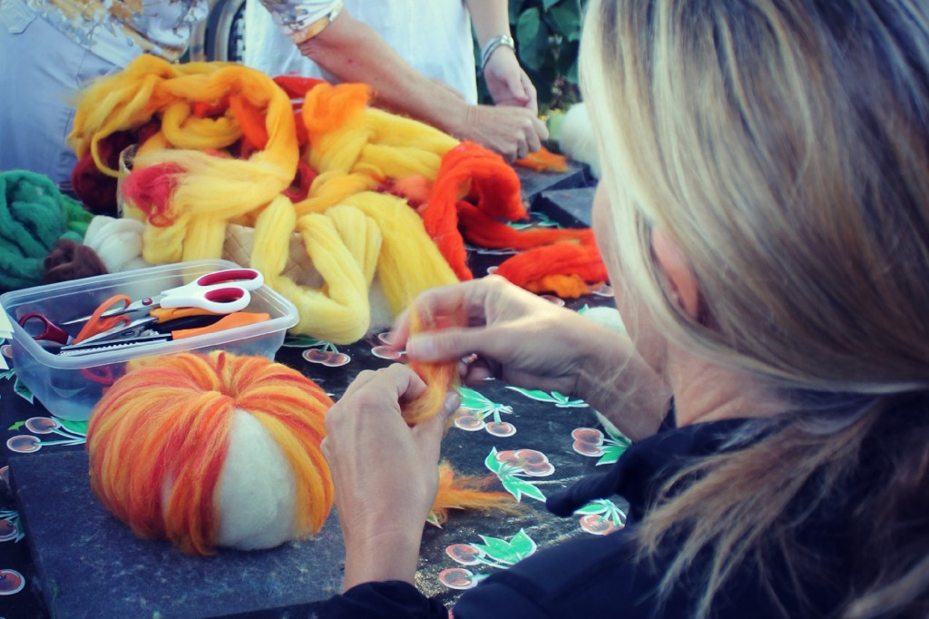 131015 Cathy adding thin strips of wool tops to form variegated textures on needle-felted pumpkin