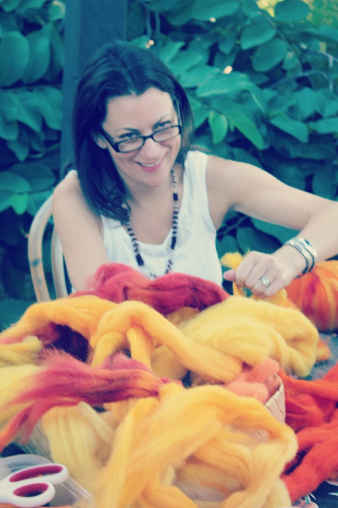 131015 Heather amidst a pile of hand-dyed natural wool top roving