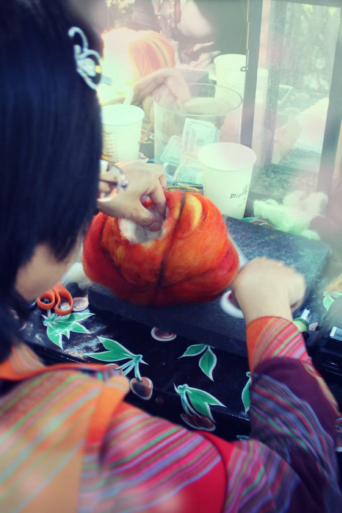 131015 Josephine cutting a door in her dry needle-felted pumpkin mouse house