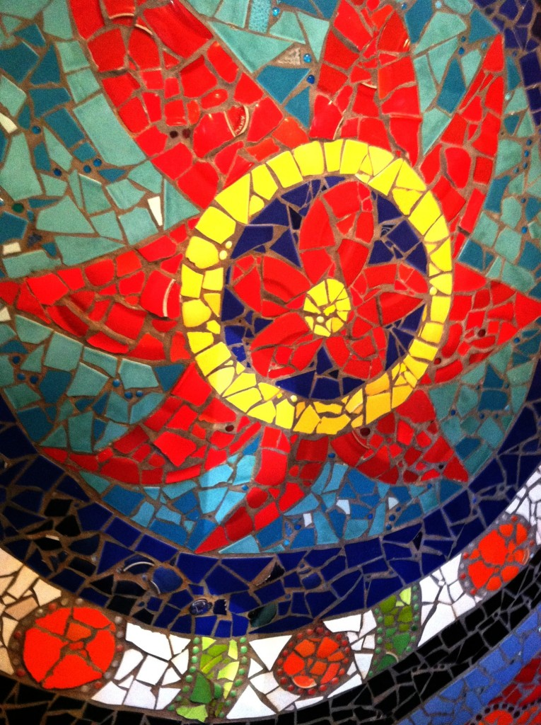 131015 Rachel Skelly red flaming floral radiating sun with concentric blue discs