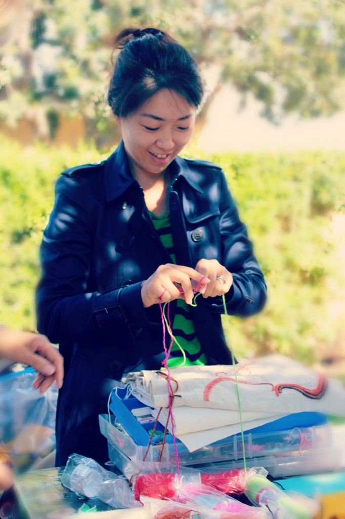 131029 Gloria making cinching string for hand-embroidered bag