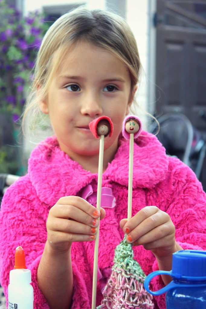 131029 Mia and her illustrated doll faces on her handmade wooden knitting needles.
