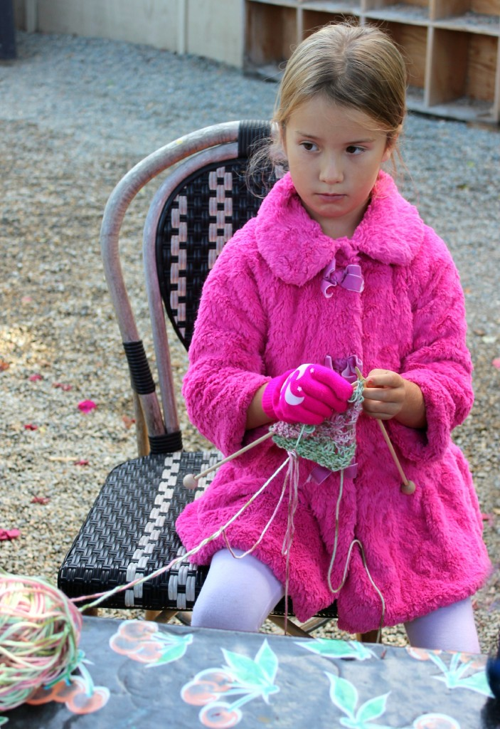 131029 Mia knitting a blanket bag for her handmade baby dolly