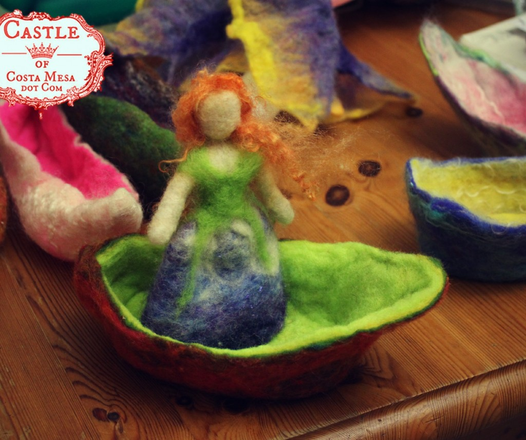 131030 Auburn flower fairy in lime green and brown wet-felted boat