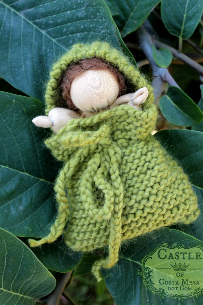 131105 Yvonne's Waldorf style simple baby doll in a green knitted blanket pocket.