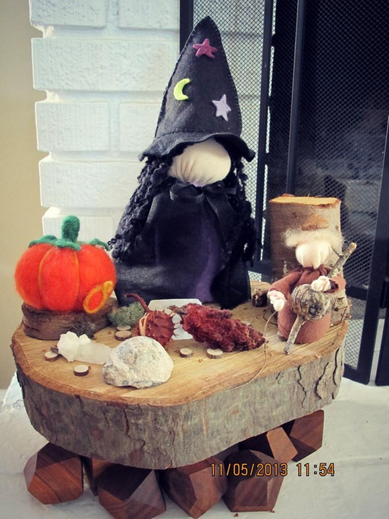 131107 Heather Sebring's completed Table Top Puppet Witch doll on her fall naturre table with a needle-felted pumpkin, acorn child and found natural objects.
