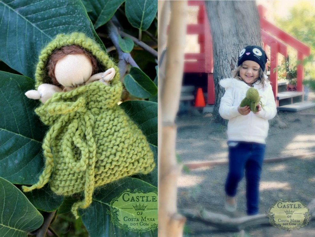 131105 Mommy handmade is always the best. Valentina smiling and playing with her mother's handmade simple Waldorf baby doll in a knitted green blanket.