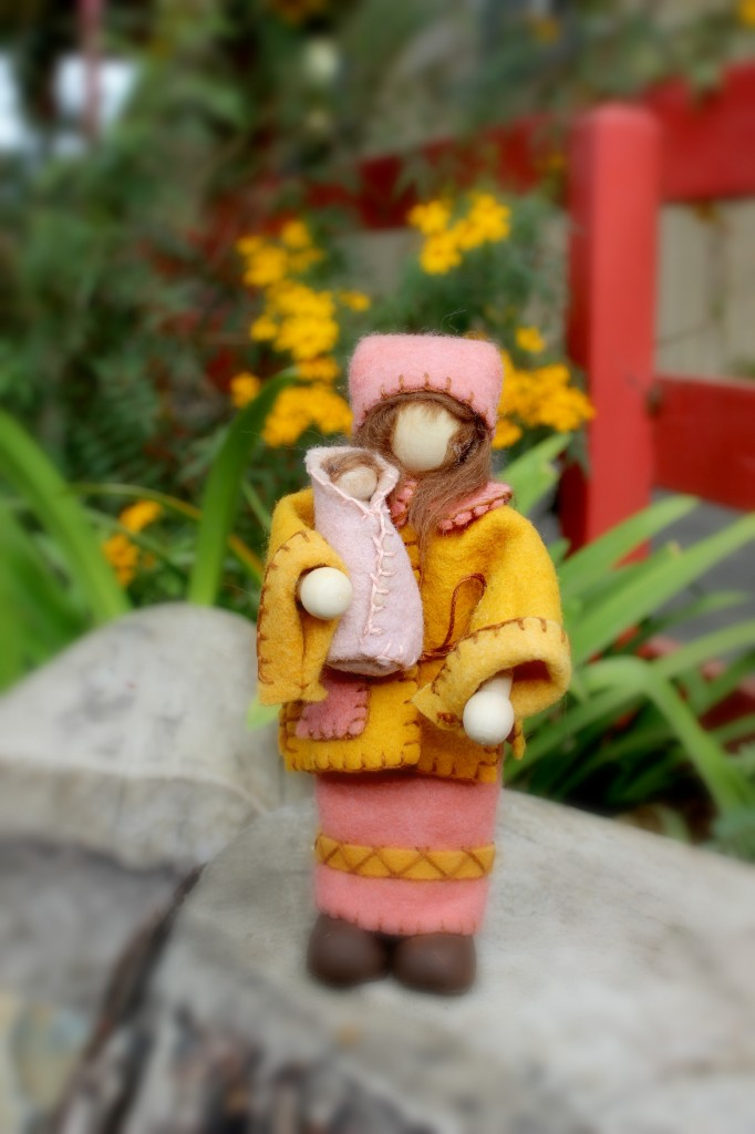 131112 Christine's mother and child gnome dolls in front of yellow flowers by the company of angels school store