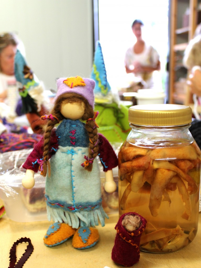 131119 Gisela's bendy doll girl gnome and her gnome baby beside Alena's homemade apple cider at craft group.