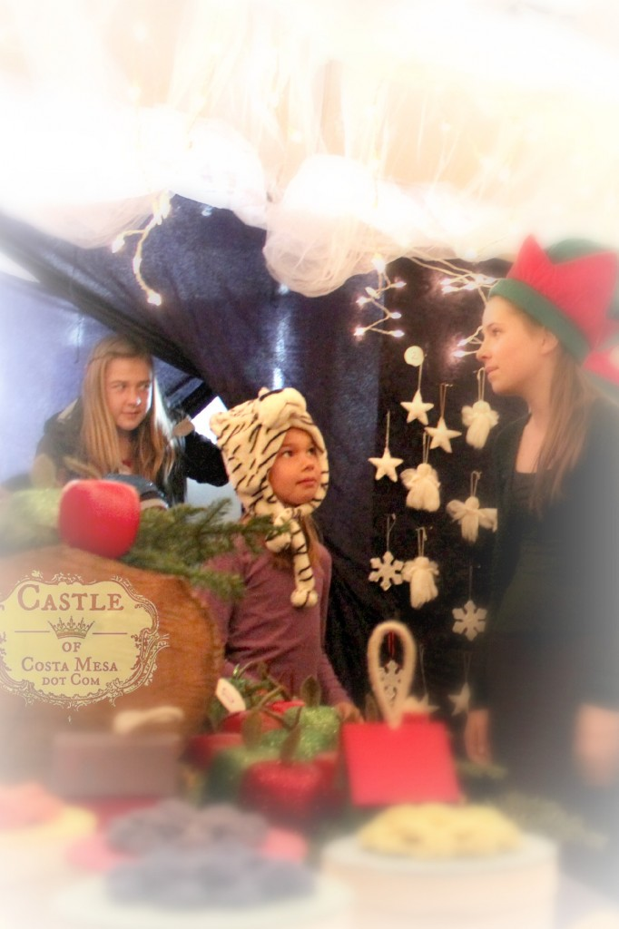 131207 Closeup shot first little shoppers entering Elves Workshop in awe