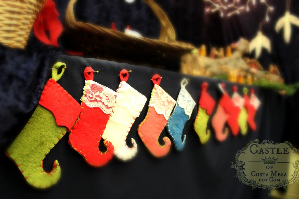 131207 Felt elf's Christmas stockings hanging in a row.