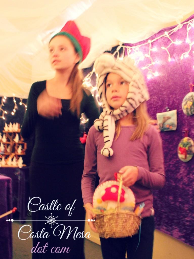 131207 First child entering Elves Workshop picked a fluffy needle-felted toadstool cottage picture for her basket