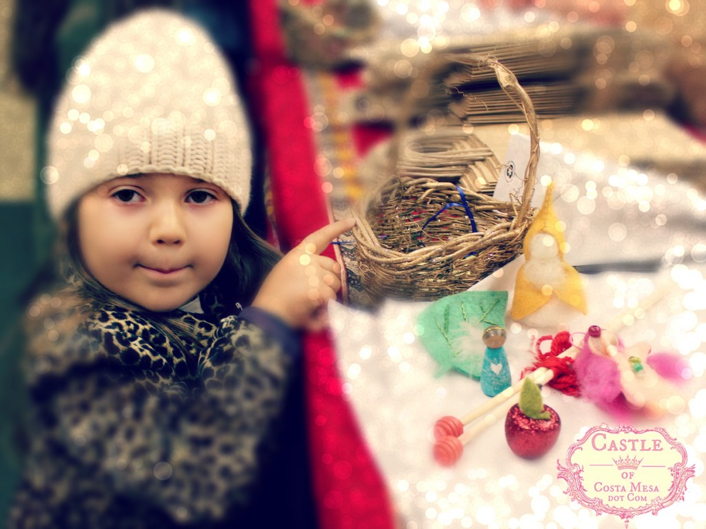 131207 Little girl in white cap showing her basket of treasures from the Elves Workshop