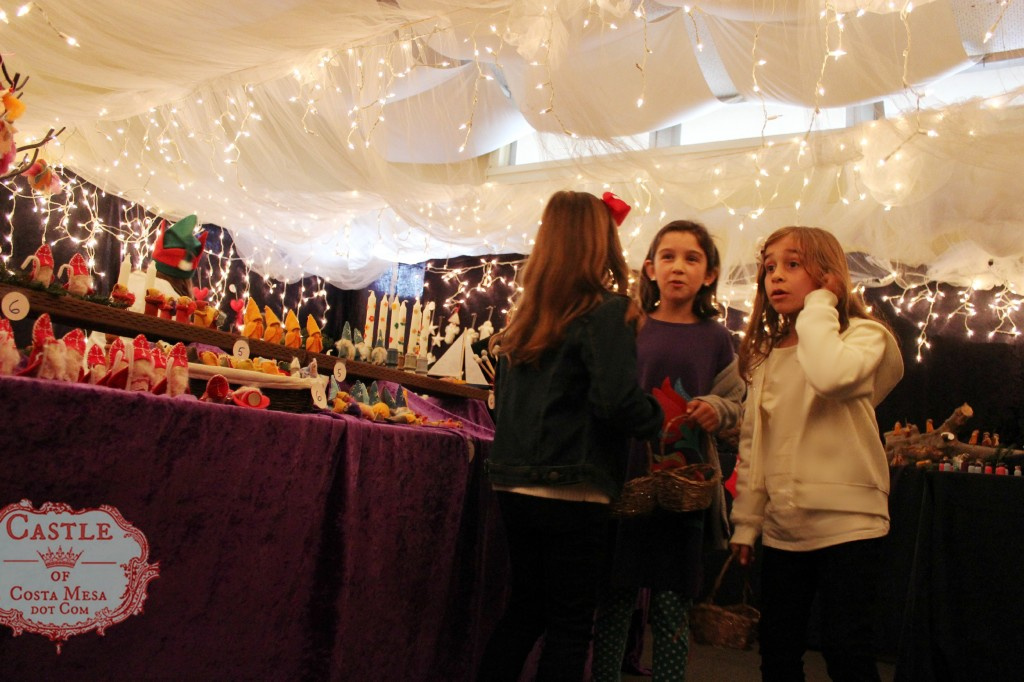131207 Three girls in awe with the plethora of choices at Elves Workshop