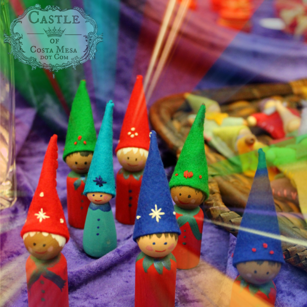 131207 Wooden peg dolls with sweet painted faces and felt pointy caps