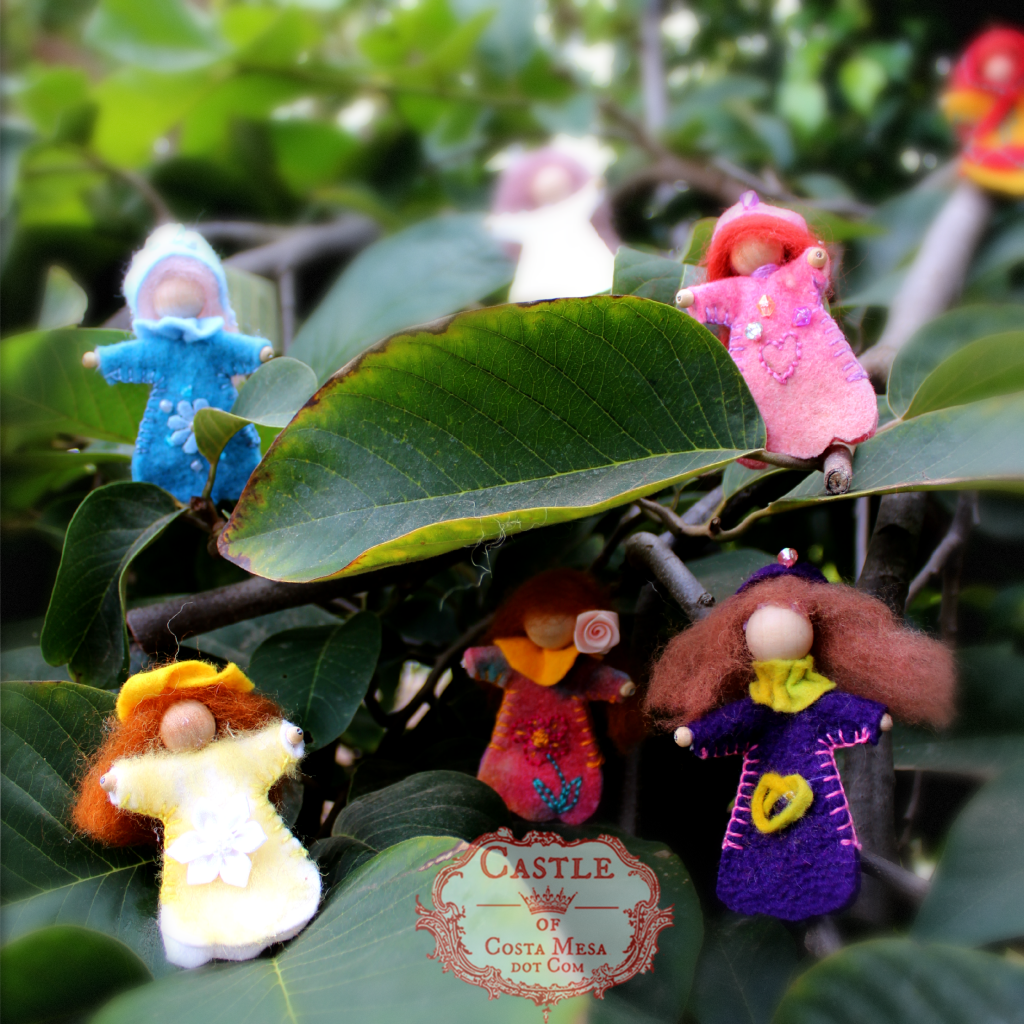 131209 Alena's blossom fairies playing hide and seek in the cherimoya tree. Square cropped