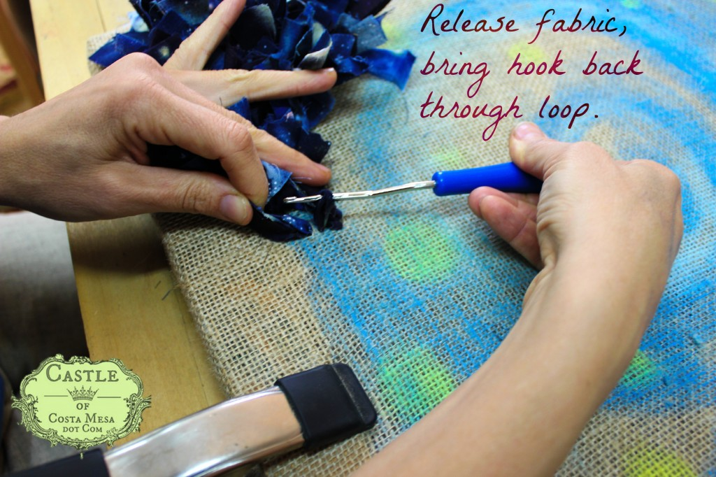 140107 Hooked Rug tutorial Release fabric, bring hook back through loop. with text