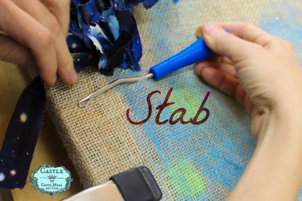 140107 Hooked rug tutorial Stab your hook through the open weave of your burlap base with a latch tool or crochet hook.
