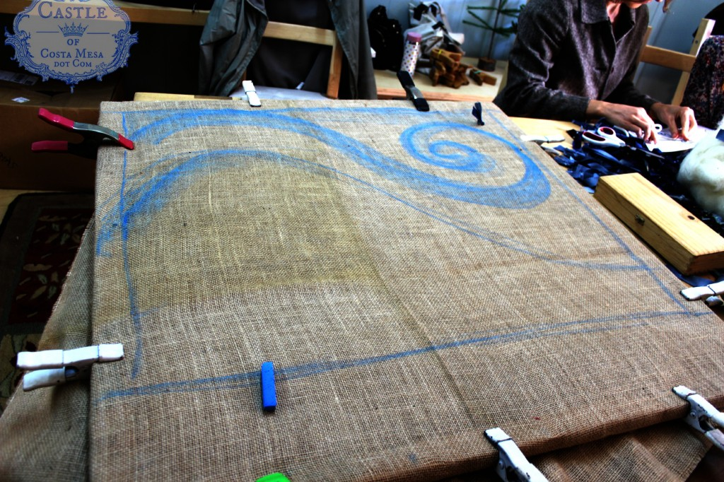 140107 sketching out rug design onto stretched burlap on wooden frame