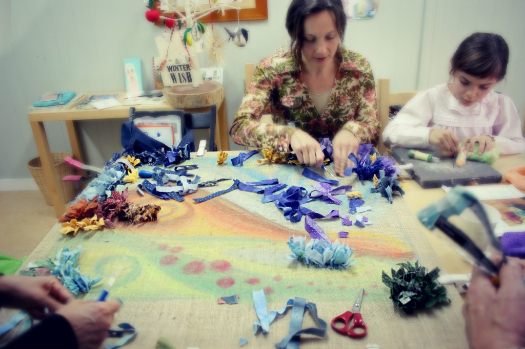 140121 Alena hooking rag rug alongside with Anna needle-felting guardian doll