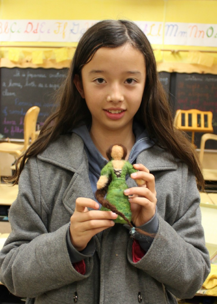 140210 6th Grader Hannah with her newly needle-felted medieval maiden in green with long braid