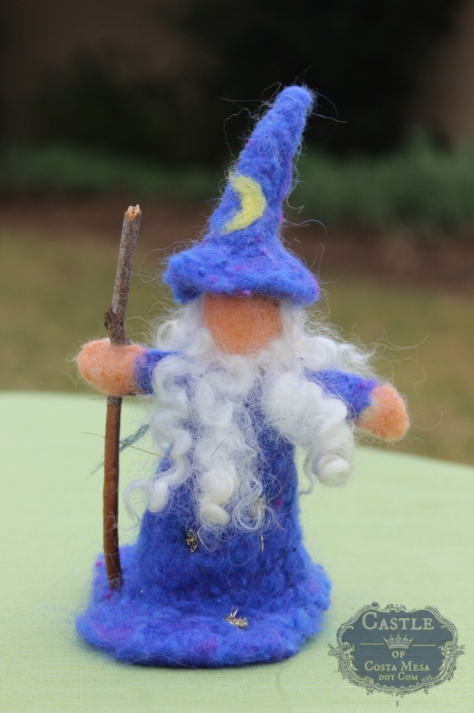 140210 Yvonne's needle-felted Merlin the Wizard with twin staff by flag pole
