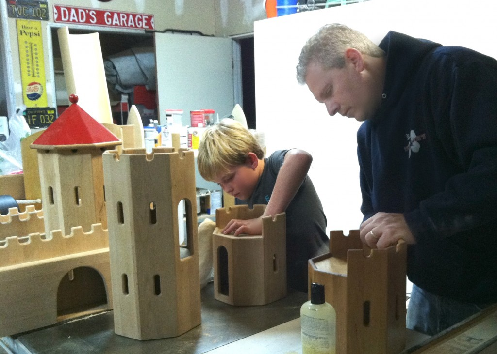 140212 Cole and Jonah Hellar oiling the Schlingl German wooden castle
