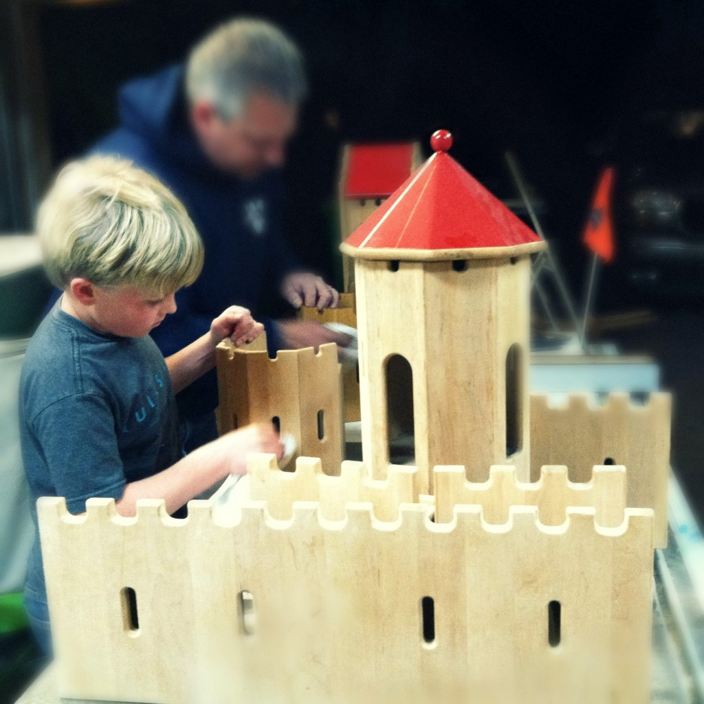 140212 Jonah in the foreground oiling the castle with mineral oil 2