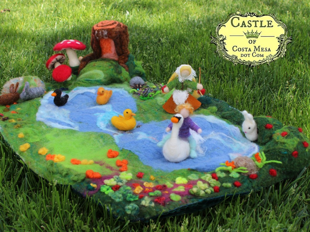 140304 Hansel riding white swan on lilly pond playscape