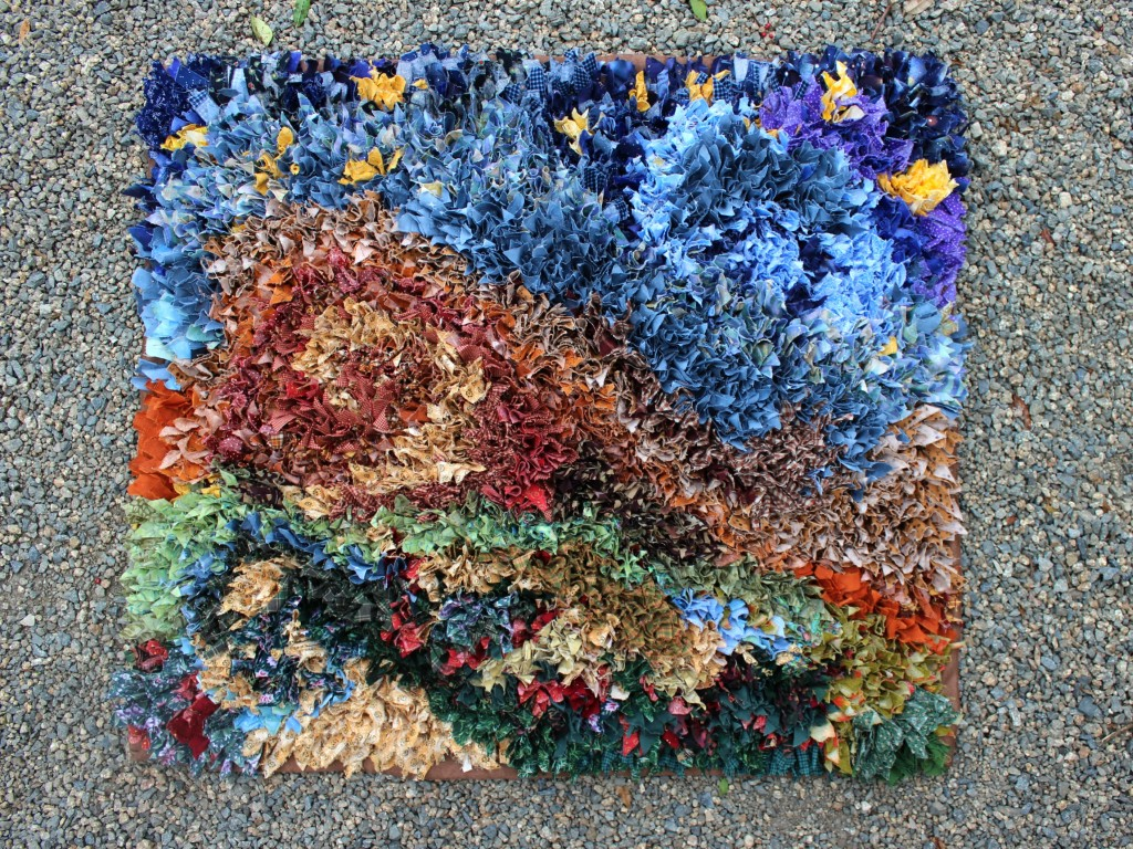 140313 The hooked rag rug is finally completed display on gravel 2 cropped 3x4