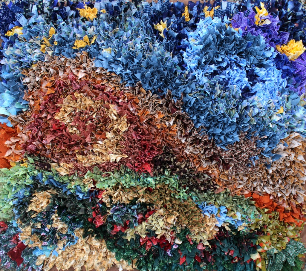 140313 The hooked rag rug is finally completed display on gravel 4 irregular close cropped