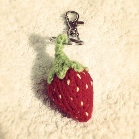 140122 Knitted red strawberry with white seeds keychain.