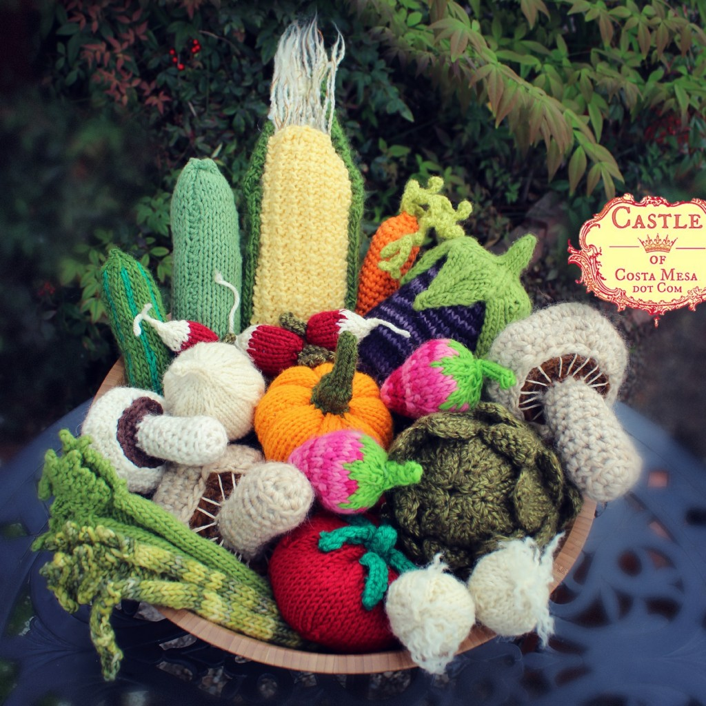 130311 Stone Soup knitted and crocheted vegetables and other ingredients in a wooden salad bowl. square cropped with logo