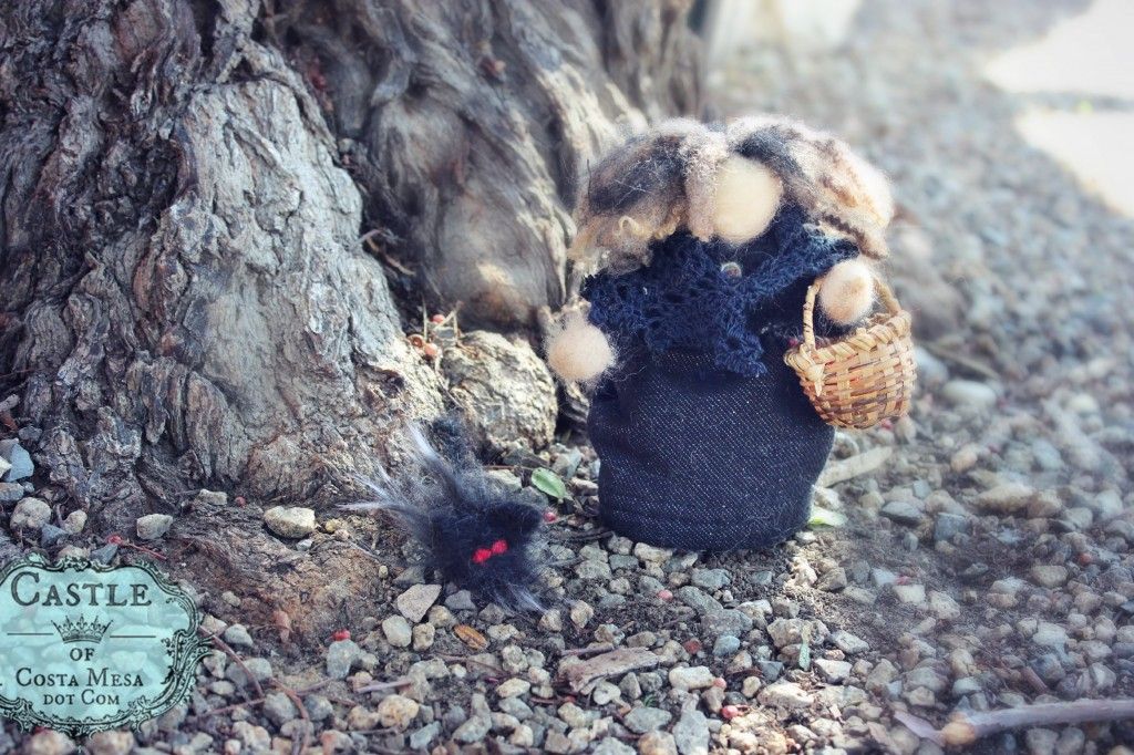 140310 Hannah's handmade doll witch and her black fuzzy cat on a stroll on rocky path