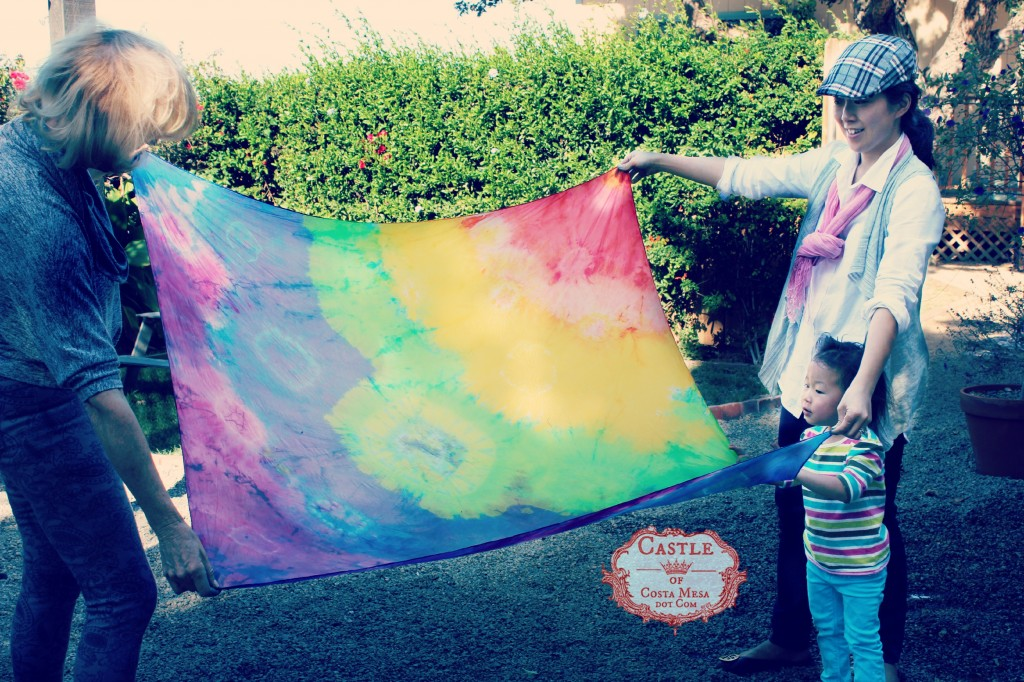 140114 Gloria unfurling her rainbow silk shibori scarf after rinsing
