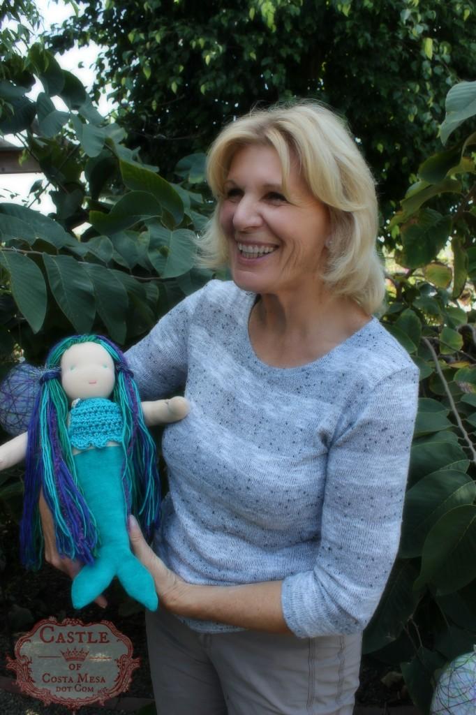 140408 Christine Newell holding her 16 inch waldorf handmade mermaid doll.