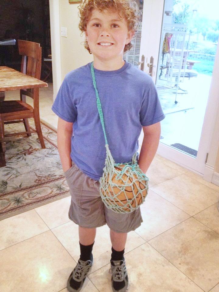140313 Third Grader Nathan and his crocheted ball holder