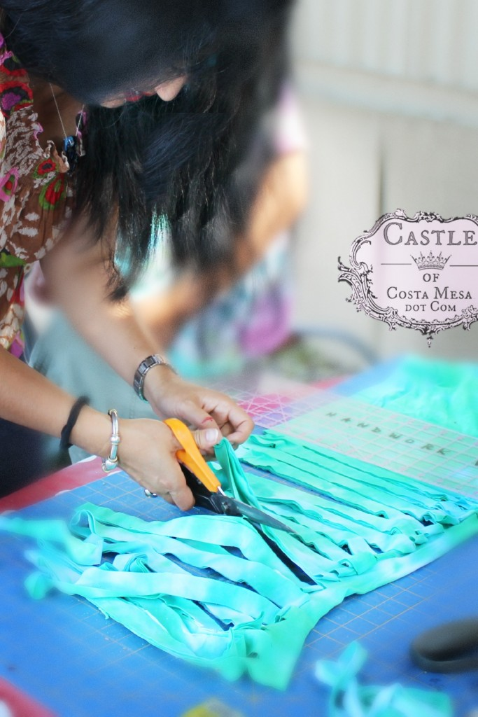 140917 Cathrine cutting 1 inch wide strips of hand-dyed T-shirt to make yarn 2
