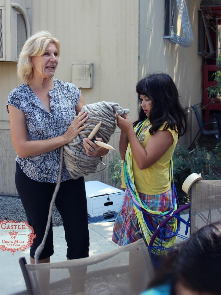140922 Christine with big bundle of large loopy mango yarn and huge knitting needles 2